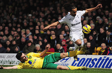 Benoit Assou Ekotto of Spurs is tackled by Robert Snodgrass of Norwich City during their match on Wednesday