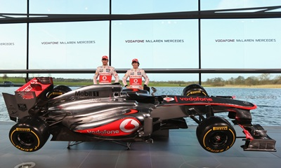 McLaren Mercedes Formula 1 drivers Jenson Button of Great Britain and Sergio Perez of Mexico unveil the Mercedes McLaren MP4-28 at the McLaren technology centre in Woking, England.