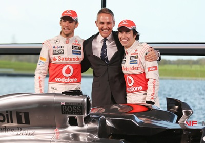 Jenson Button (L) and Sergio Perez (R) with team principal Martin Whitmarsh at the unveiling