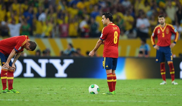 Xavi Hernandez of Spain prepares to kick off with teammate Fernando Torres (left) after conceding their third goal