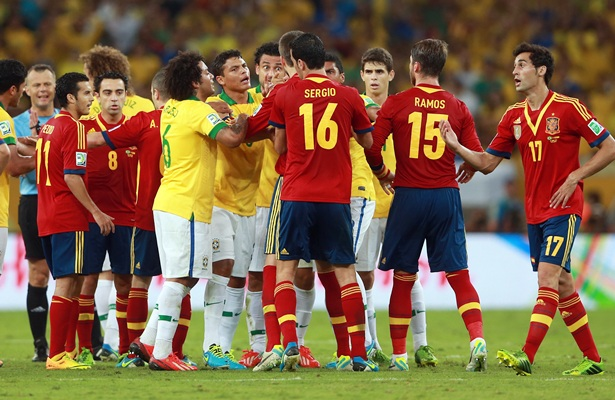The Brazil and Spain players argue