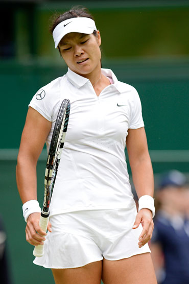 Na Li of China reacts during her quarter-final against Agnieszka Radwanska of Poland