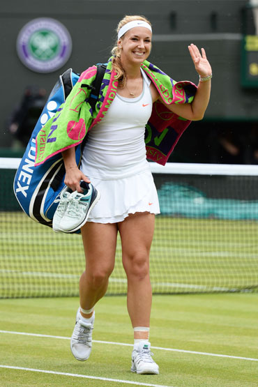 Sabine Lisicki of Germany waves to the crowd as she leaves court following her victory over Kaia Kanepi of Estonia