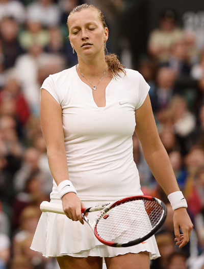 Petra Kvitova of Czech Republic looks dejected after her loss to Flipkens