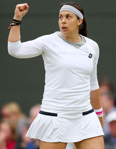 Marion Bartoli of France celebrates a point