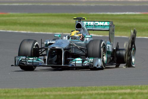 Lewis Hamilton has a left rear tyre failure