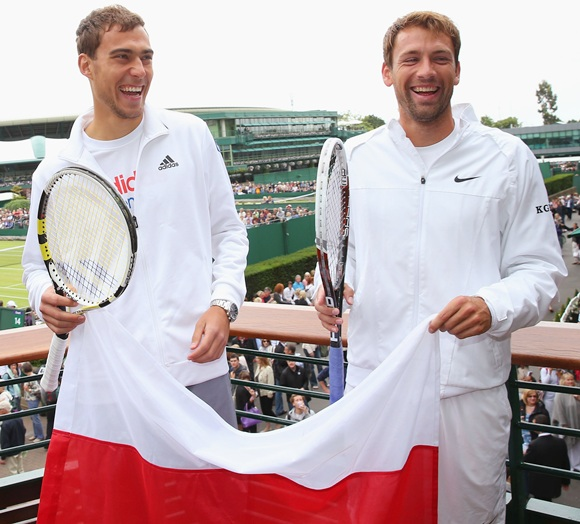 Jerzy Janowicz and Lukasz Kubot of Poland pose together as a preview to Thursday's quarter final match