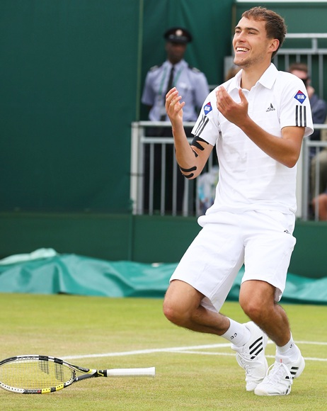 Jerzy Janowicz of Poland celebrates match point