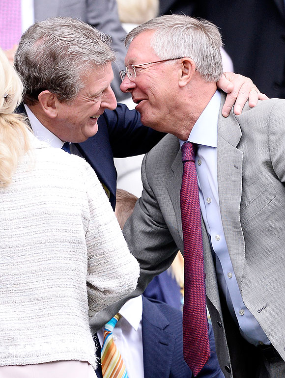 Roy Hodgson greets Sir Alex Ferguson in the Royal Box on centre court before the men's singles quarter-final between David Ferrer of Spain and Juan Martin Del Potro of Argentina at the All England Lawn Tennis and Croquet Club at Wimbledon on Wednesday