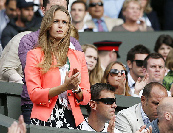 Kim Sears, the girlfriend of Andy Murray of Britain, celebrates as Andy Murray beat Fernando Verdasco in the quarters at the Wimbledon Tennis Championships, in London on Wednesday