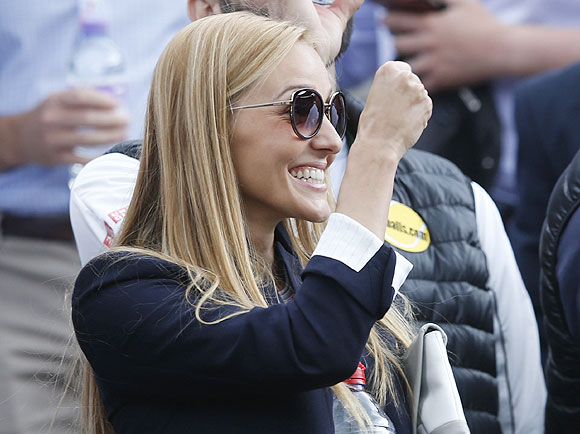 Jelena Ristic, the girlfriend of Novak Djokovic, is ecstatic after Djokovic defeated Tomas Berdych  in their men's quarter-final tennis match at the Wimbledon Tennis Championships, on Wednesday