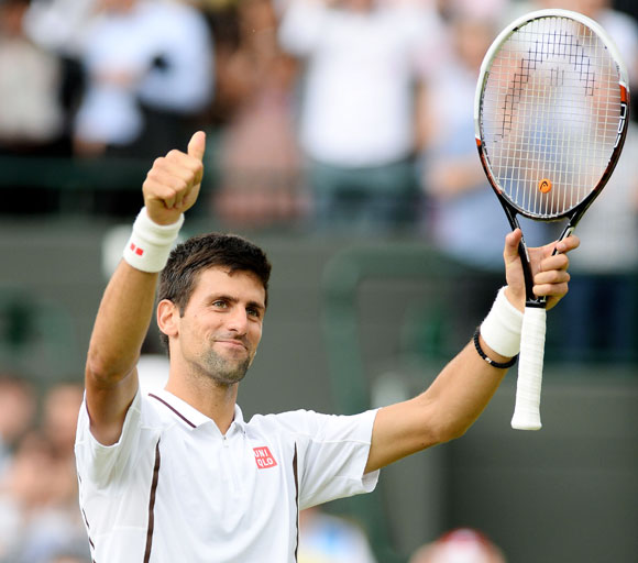 Novak Djokovic of Serbia celebrates victory gainst Tomas Berdych of Czech Republic