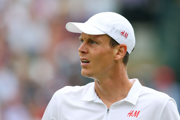 Tomas Berdych of Czech Republic reacts in his match against Djokovic