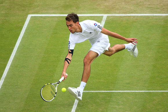 Jerzy Janowicz of Poland plays a forehand during his quarter-final against compatriot Lukasz Kubot