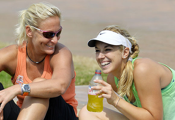 Sabine Lisicki of Germany (R) smiles during a training session with Barbara Rittner, the captain of the German Fed Cup team, on Friday