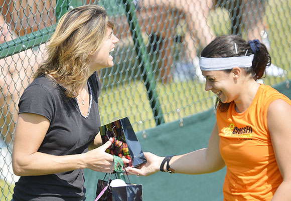 Former Wimbledon champion Amelie Mauresmo (left) and Marion Bartoli share a light moment during a practise session on Friday
