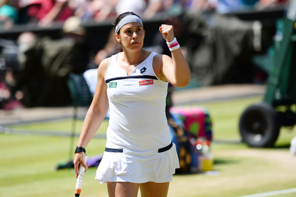 Marion Bartoli celebrates a point in the final
