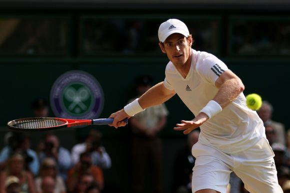 Andy Murray of Great Britain plays a forehand during the Gentlemen's Singles Final match against Novak Djokovic of Serbia on day thirteen of the Wimbledon Lawn Tennis Championships at the All England Lawn Tennis and Croquet Club