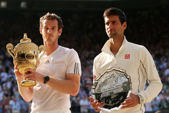 Andy Murray of Great Britain poses with the Gentlemen's Singles Trophy next to Novak Djokovic of Serbia following his victory in the Gentlemen's Singles Final match