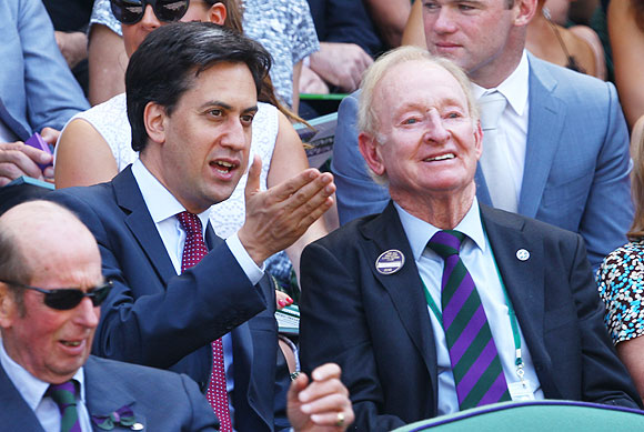 Leader of the Labour Party Ed Miliband speaks with legendary tennis star Rod Laver before the Wimbledon men's final between Andy Murray a