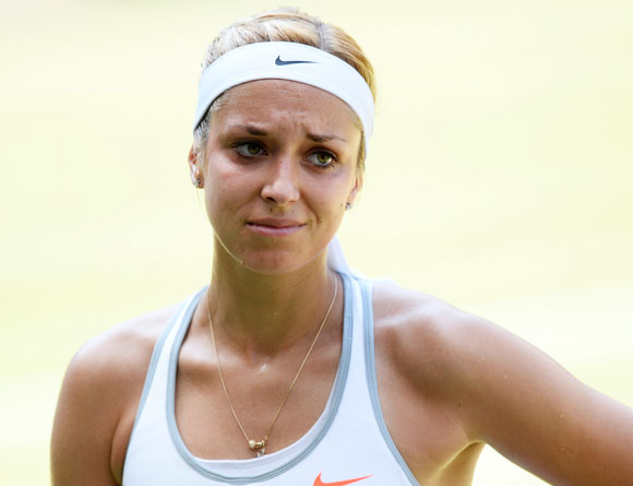 Sabine Lisicki of Germany reacts during the Ladies' Singles final against Marion Bartoli of France