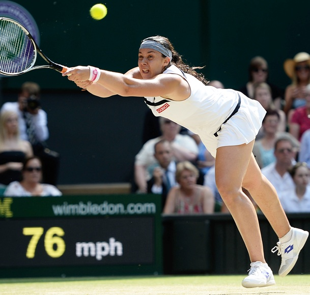 Marion Bartoli of France plays a forehand