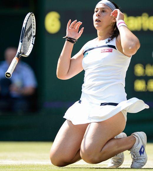 Marion Bartoli of France celebrates championship point