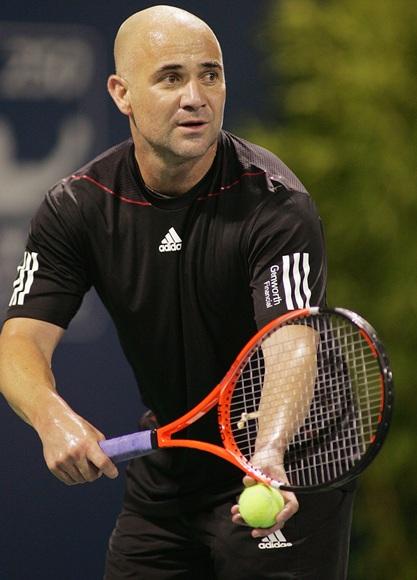 Andre Agassi serves