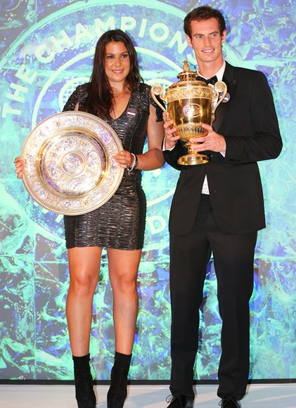 Marion Bartoli of France poses with the Venus Rosewater Dish trophy and Andy Murray of Great Britain poses with the Gentlemen's Singles Trophy