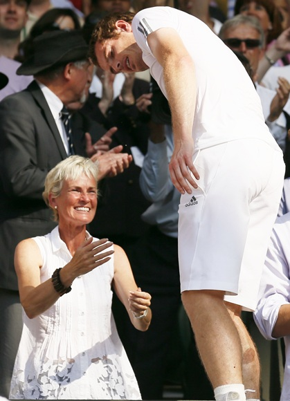 Andy Murray of Britain greets his mother