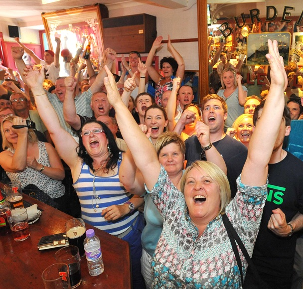 Dunblane residents watch local boy Andy Murray of Great Britain play Novak Djokovic