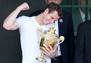 Andy Murray of Britain holds the winners trophy on the clubhouse balcony after defeating Novak Djokovic of Serbia to win the Wimbledon crown on Sunday