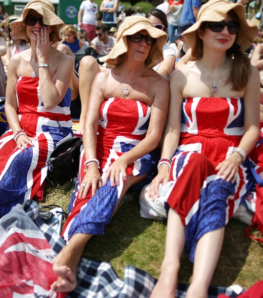 Spectators wearing Union flag decorated dresses