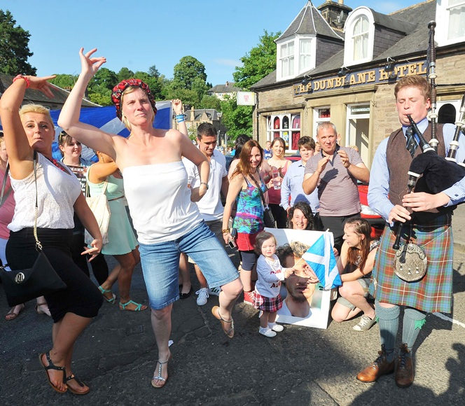 Dunblane residents take to the streets to celebrate after watching local boy Andy Murray of Great Britain beat Novak Djokovic