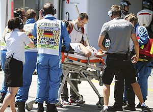 A cameraman is carried on a stretcher after being injured by a lost rear tyre of Red Bull Formula One driver Mark Webber of Australia during the German F1 Grand Prix at the Nuerburgring circuit on Sunday