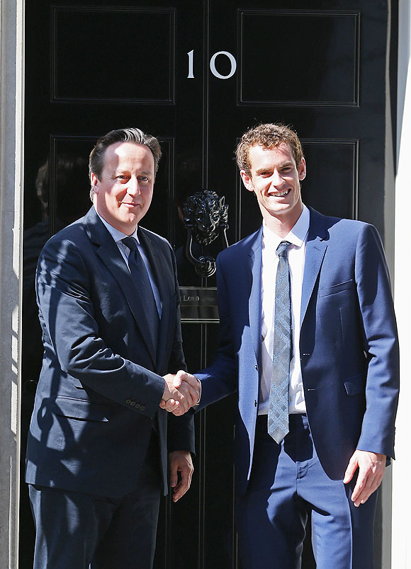 Andy Murray is greeted by British Prime Minister David Cameron at Number 10 Downing Street on Monday