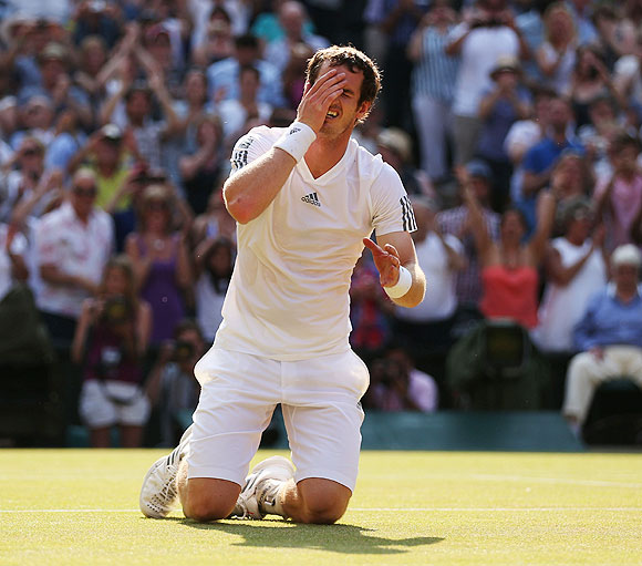 Andy Murray of Great Britain celebrates Championship point during the Wimbledon final against Novak Djokovic on Sunday