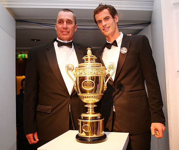 2013 Wimbledon champion Andy Murray poses with coach Ivan Lendl (left) during the Wimbledon Championships 2013 Winners Ball at InterContinental Park Lane Hotel on Sunday