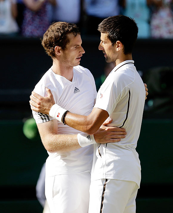 Andy Murray is congratulated by Novak Djokovic