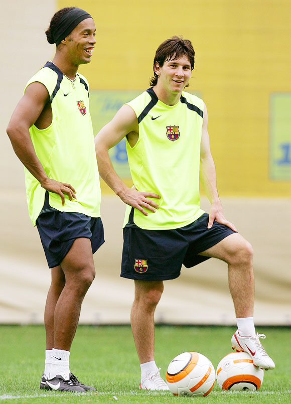 Ronaldinho and Lionel Messi at FC Barcelona's training session in August 2005
