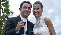 Barcelona midfielder Xavi with wife Nuria Cunillera