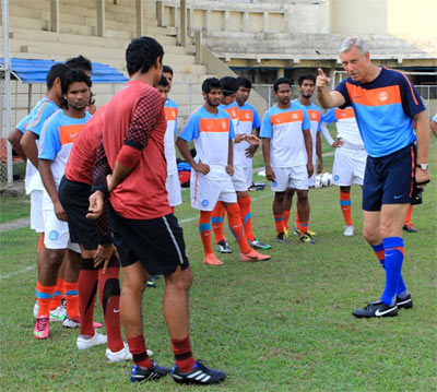 India football coach Wim Koevermans speaks to the players during a training session