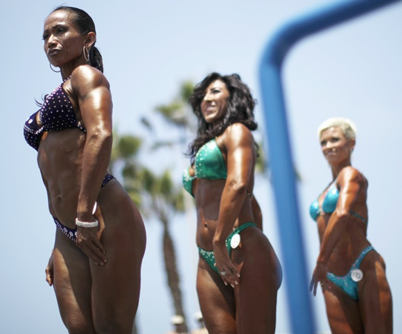 Women compete in the Muscle Beach Independence Day bodybuilding contest