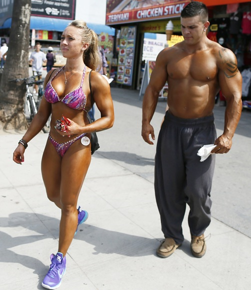 A couple arrives to compete in the Muscle Beach Independence Day bodybuilding contest