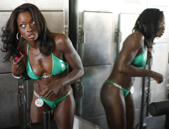 Muscle Beach bodybuilding has bikinis, spray tan, hair spray...
