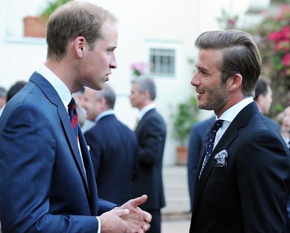 Prince William, Duke of Cambridge, speaks with David Beckham