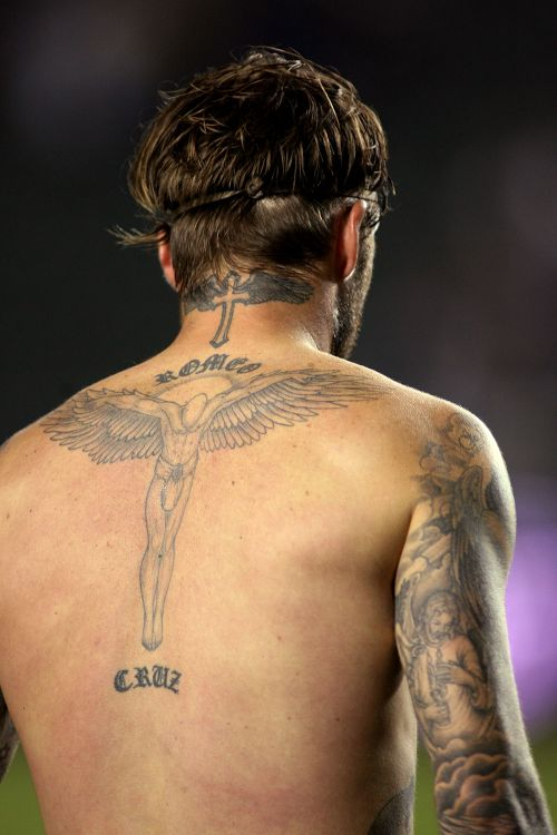 Photos david beckham 39 s obsession with tattoos explained for David beckham back tattoo
