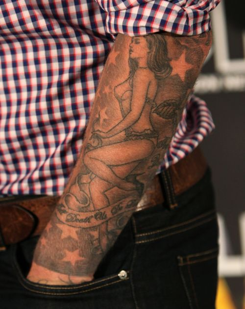 Photos david beckham 39 s obsession with tattoos explained for David beckham arm tattoo