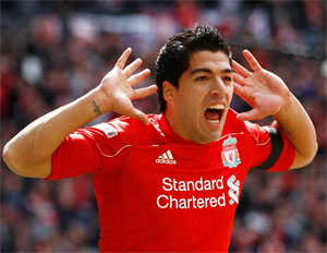 Controversial Suarez Twitter's top trending football star of 2013
