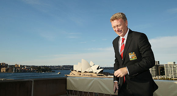David Moyes smiles after taking a photo of Sydney Harbour